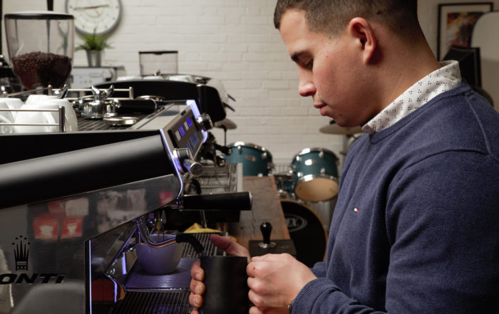 Caffeine Barista Trainer Joe Stockwell making coffee
